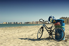 Bike On The Beach Photo by Rodger E Clark